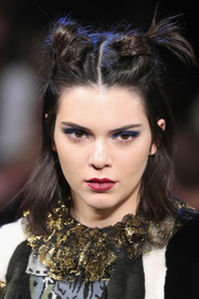 Kendall Jenner wore a punk-glam knotted half-up 'do on the Anna Sui runway.