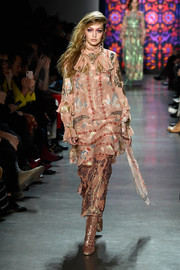 Gigi Hadid looked ultra girly in a tiered pink print dress at the Anna Sui runway show.