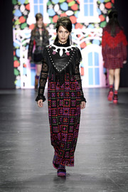 Bella Hadid walked the Anna Sui show wearing a printed maxi dress with a leather bodice and lace sleeves.