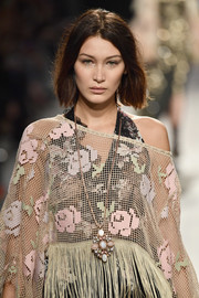 Bella Hadid walked the Anna Sui runway wearing a lovely gemstone pendant necklace.
