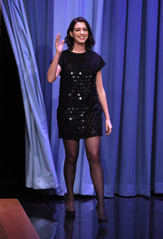 Anne Hathaway sparkled in a mirror-embellished LBD by Saint Laurent while appearing on 'The Tonight Show Starring Jimmy Fallon.'