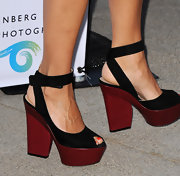 Rashida rocked sky-high platform sandals at the 'Helmut Newton: White Women - Sleepless Nights - Big Nudes' exhibit.