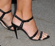 Cindy Crawford donned black strappy sandals with silver circular studs.