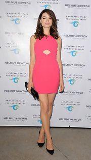 Crystal Reed showed just a peek of skin with this hot pink cutout dress.