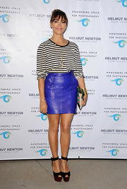 Rashida's electric blue leather mini skirt added a cool pop of color to her black and white top.