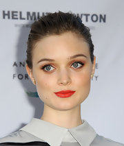 Bellas red lipstick featured a slight orange undertone for a red shade that totally complemented her fair skin.