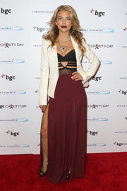 AnnaLynne McCord looked totally red carpet-ready in a double-slit burgundy maxi skirt teamed with a black cutout top at the Cantor Fitzgerald Charity Day event.