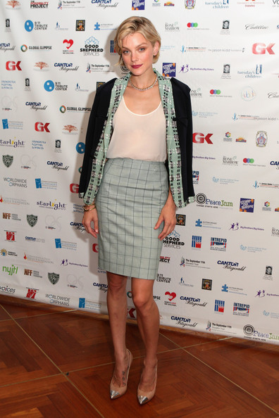 Jessica Stam attended NYC's Charity Day event with a black and mint blazer chicly slung over her shoulders.