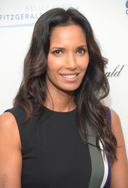 Padma Lakshmi attended the Cantor Fitzgerald Charity Day event wearing her hair with a center part and casual waves.