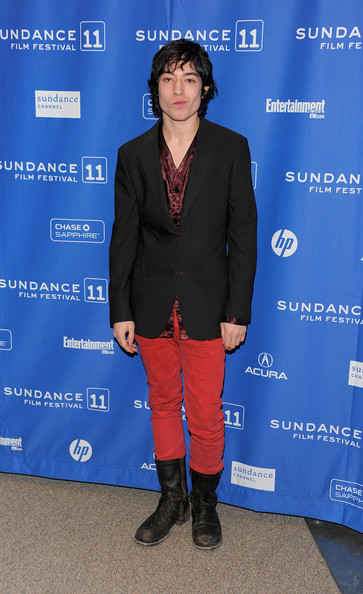 Ezra dons a classic black blazer over red pants and a silk blouse for the Sundance Film Festival.