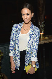 Jessica Alba's yellow box clutch provided a nice color contrasted to her blazer.