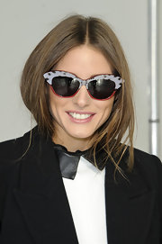 Funky cateye sunglasses made Olivia Palermo's look quirky at the Antonia Berardi runway show.