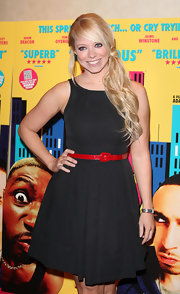 Liz wears a classic LBD with a tiny red patent belt for the UK premiere of Anuvahood.