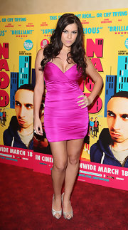 Imogen donned a hot pink body con dress for the Anuvahood UK film premiere.