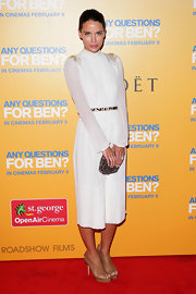 Jodi topped off her white dress with cognac platform booties.