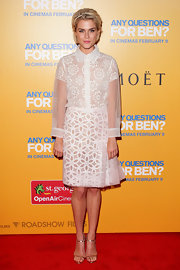 Rachael Taylor topped off her white frock with gold strappy sandals.
