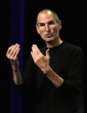Steve Jobs wears his hair in a short buzzcut.