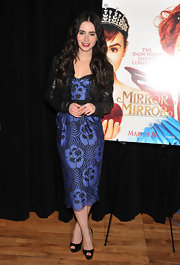 Lily Collins attended an event promoting her movie 'Mirror Mirror' wearing a pair black platform peep toe pumps.