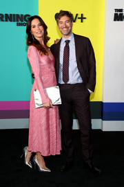 Katie Aselton attended the world premiere of Apple TV+'s 'The Morning Show' carrying a metallic silver clutch by Clare Vivier.