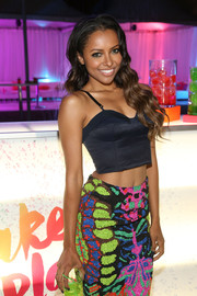 Kat Graham put her flat abs on display in a cropped blue corset top during the Aquafina FlavorSplash launch.