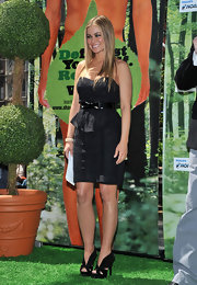 Carmen rocked a hot pair of black patent leather and suede cutout slingbacks with her strapless LBD.