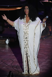 Aretha Franklin donned an Egyptian inspired beaded evening dress for her concert in Tennessee.