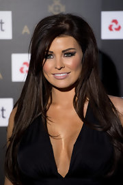 Jessica Wright wore her impossibly long hair in sleek layers while attending the Ariella Couture runway show in London.