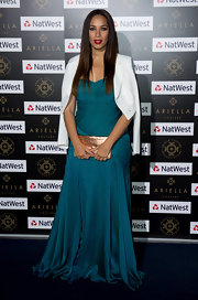 Leona Lewis looked divine in this teal chiffon gown at the Ariella Couture fashion show.