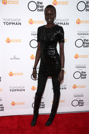 Alex Wek paired her sparkly dress with black knee-high boots for an edgy finish.