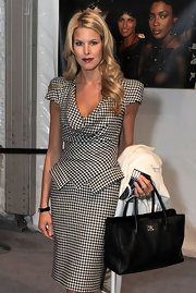Beth stops to pose for the cameras at Fashion Week in New York. She showed off her leather Chanel tote, which was a nice add on to her Alexander Mqueen dress.