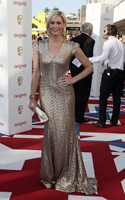 Jenni Falconer channeled her inner goddess in this stunning gold gown at the British Academy Television Awards in London.