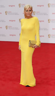 Michelle Collins' bright yellow long-sleeve dress had a fun and summer vibe to it on the red carpet.