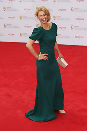 Myanna Buring chose this floor-length dark green gown with puffed sleeves for her lovely and sophisticated look at the BAFTA TV Awards.
