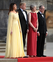 Melania Trump looked downright regal in a caped yellow off-the-shoulder gown by J. Mendel at the arrival ceremony at Blenheim Palace.