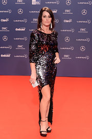 Nadia Comaneci sparkled on the Laureus World Sports Awards' red carpet when she wore this sequin gown with front slit.