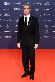 Kyle MacLachlan sported a classic black suit for his red carpet appearance at the 2013 Laureus World Sports Awards.