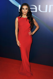 Eva Longoria matched the red carpet in this vibrant red column-style gown.