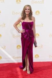Allison Janney went for a romantic vibe at the Emmys with this bow-adorned wine-colored velvet strapless gown by Nicholas Jebran.