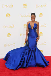 Keke Palmer cut an ultra-feminine silhouette on the Emmys red carpet in a cobalt Rubin Singer strapless gown featuring an exaggerated mermaid hem.