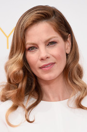 Michelle Monaghan attended the Emmys wearing her hair in retro-glam curls.