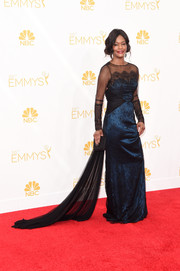 Sufe Bradshaw looked regal at the Emmys in a two-tone Gustavo Cadile lace and silk gown with a long train.