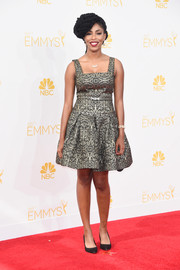 Jessica Williams shone in a chic brocade cocktail dress during the Emmys.