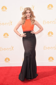 Natalie Dormer showed off her svelte figure in a body-con orange and black gown by J. Mendel during the Emmys.