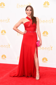 Chelsea Peretti was modern and chic in a red halter gown with a thigh-slit during the Emmys.