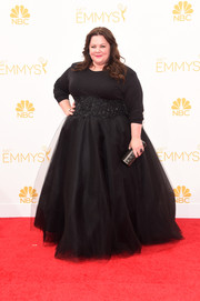 Teamed with her Marchesa skirt, Melissa McCarthy's long-sleeve tee took on a glamorous feel.