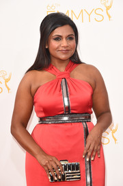 Mindy Kaling accessorized with a chic black and gold box clutch by Kotur at the 2014 Emmy Awards.