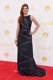 Debra Messing was modern-chic at the Emmys in a midnight-blue Angel Sanchez gown featuring sheer geometric accents.