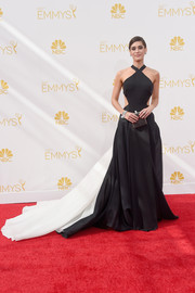 Lizzy Caplan was sexy-glam at the Emmys in a black-and-white Donna Karan Atelier halter gown featuring waist cutouts and a long train.