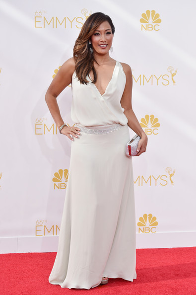 Carrie Ann Inaba donned a flowy white gown, featuring a deep-V neckline and a bedazzled belt, for the Emmys.
