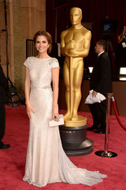 Maria Menounos glistened in a pale gown by bridal designer Johanna Johnson at the 2014 Academy Awards.
